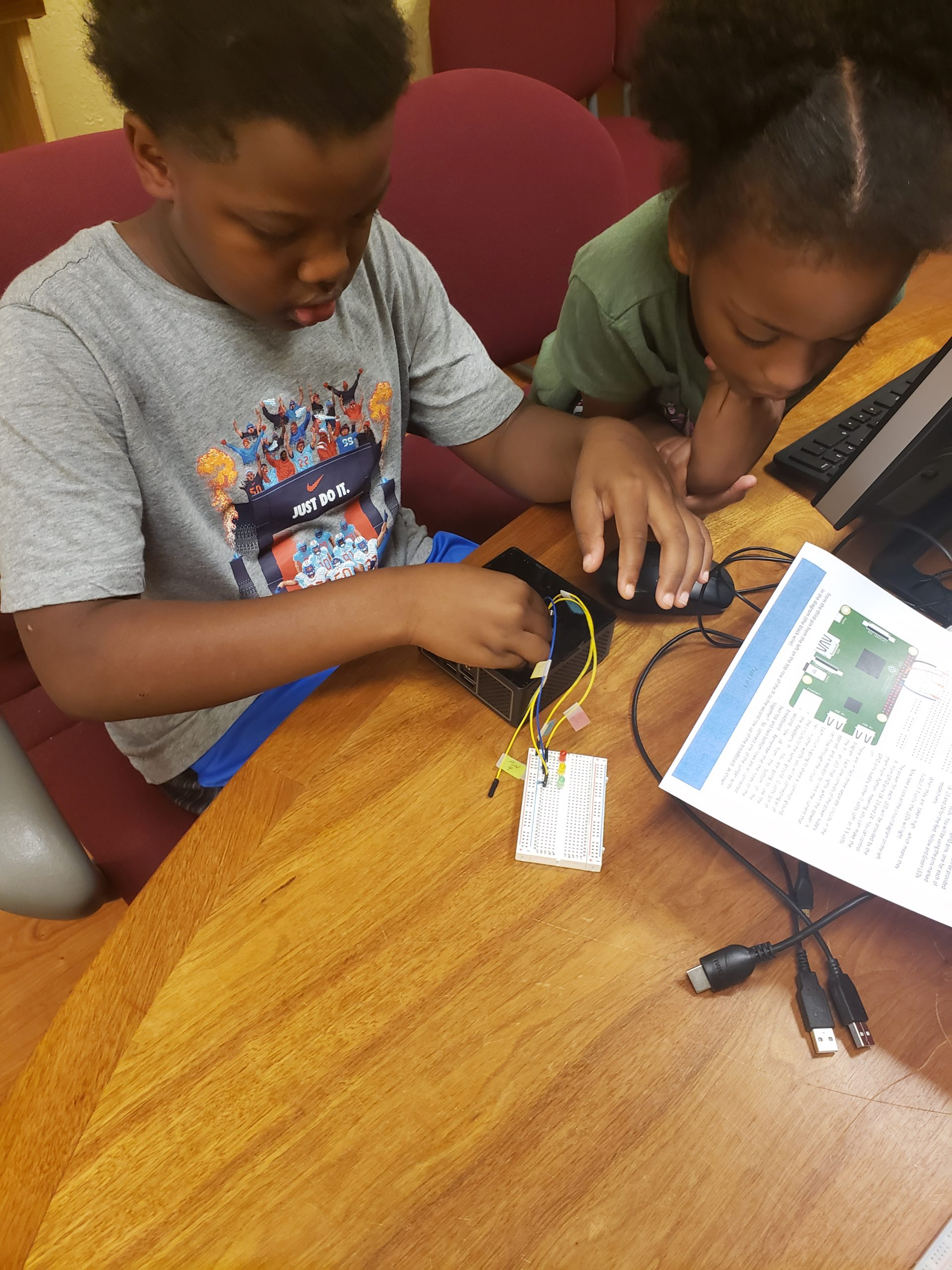 students connecting a Raspberry Pi to a breadboard